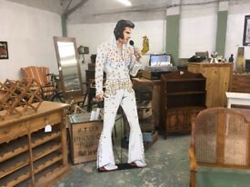 Hard board cut out of Elvis hand painted