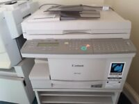 Canon GP 160 copier, with manual and stand on casters