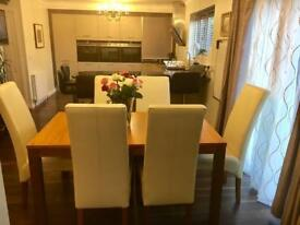 Extendable dining table and 8 leather chairs £180