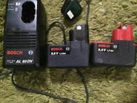 For sale one Bosch battery charger and two battery's