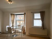 A first floor one bedroom flat , part furnished with new double glazing, GCH and newly decorated