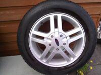 Four 15 inch alloy wheels with tyres off a ford focus.
