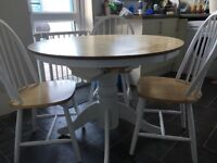 Beech wood effect/white round, extendable dining table with 6 matching chairs