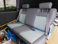 Triple bench seats with all belts attached
