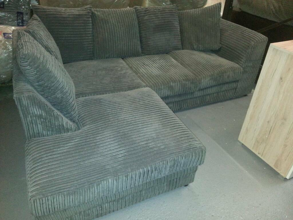 A brand new grey jumbo cord corner sofa and cuddle chair.
