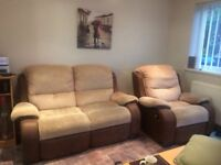 Recliner armchair and sofa.