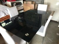 Black Glass Dinning Table 5ftx3ft with 4 white chairs