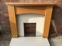 Marble fireplace and wooden surround