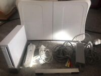 Nintendo Wii and fit board with three games