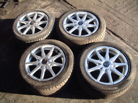 Peugeot set of four alloy 15 inch wheels and as new tires