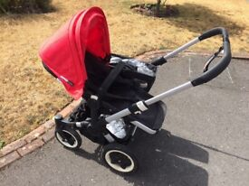 Bugaboo donkey with red hood and umbrella
