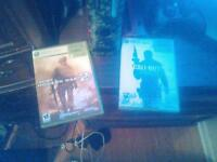 xbox 360 with 2games and a controller.