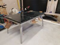 Black and silver glass extending dining table