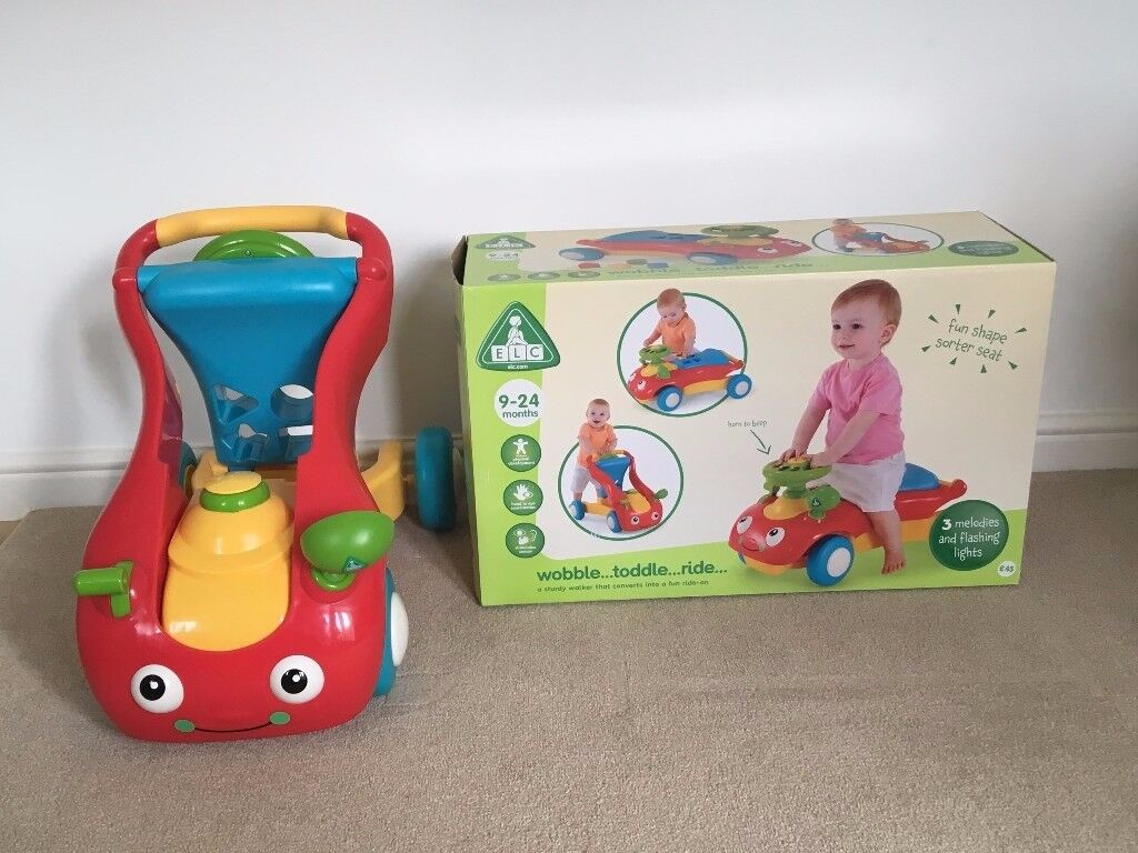 Early Learning Centre Wobble Toddle baby walker and ride on. Excellent condition with box.