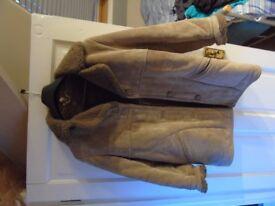 Ladies sheepskin coat, new never worn