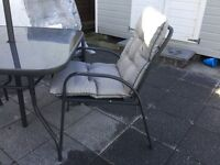 Weatherproof Garden furniture set. Table, 4 chairs and parasol