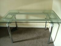 Glass Dining table, extends at both ends.