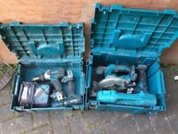 Makita boxes with drills, charger and skill saw