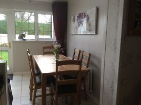 Extendable Oak Table with Six Chairs. As New. Reduced to £150 for quick sale.