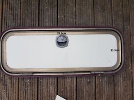 Side door with frame and key for caravan, camper or motorhome.