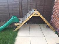 Garden climbing frame with slide