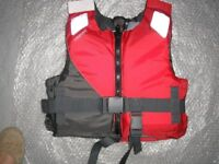 BUOYANCY AID 25-40KG. TRIBORD BY DECATHLON. THIS IS NOT A LIFEJACKET. TEACH CHILDREN TO FLOAT.
