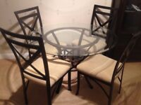 Glass table and chairs now reduced!