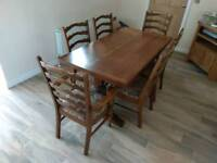 Dark oak dining table & chairs