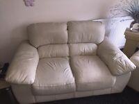 2x two seater cream leather sofa