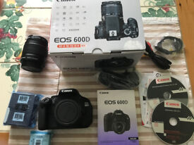 Canon EOS 600D Digital SLR with zoom lens, Lowepro rucksack, tripod and extras. Excellent condition