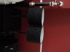 2 Black bedside or table lamps. Jacquard flock lampshades.