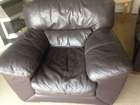 Brown leather chair and matching foot stool