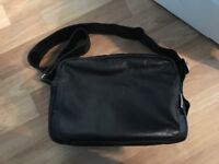 Black leather Bugaboo changing bag