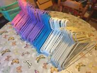 Over 100 plastic hangers. Various colours.