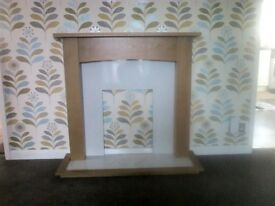 Fire surround teak effect from B & Q new still in box but too late to return it as bought last year