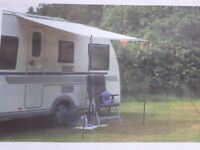 ISABELLS SUN AWNING 300 Brand new never usec with spate pole and wheel cover.