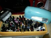 74 bottles of nail polish and 2 nail drying lamps