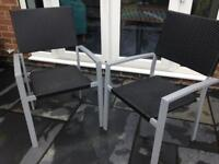 2 black rattan chairs chrome legs new £10 each