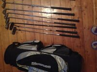 Assorted golf clubs with bag