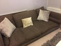 Brown DFS four seater sofa & arm chair