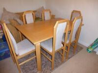 Beech dining table and six chairs. Made in Denmark, Studio8 make.