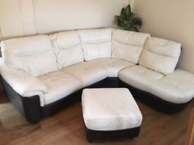 White leather sofa and comes with a little seat too.