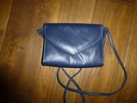 barely used small navy leather handbag with shoulder strap
