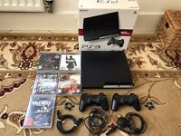 PS3 (Playstation 3) 160GB plus 5 games and 2 controllers