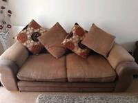 Two 2/3 brown sofas