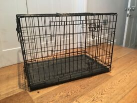 Medium sized dog crate in excellent condition