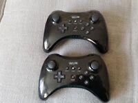 Two Nintendo wii u pro controllers