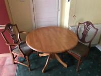 Round pine dining table and four chairs