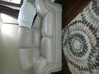 Two identical genuine leather loveseats