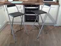 2 Black and Silver Folding Bar Stools - like new